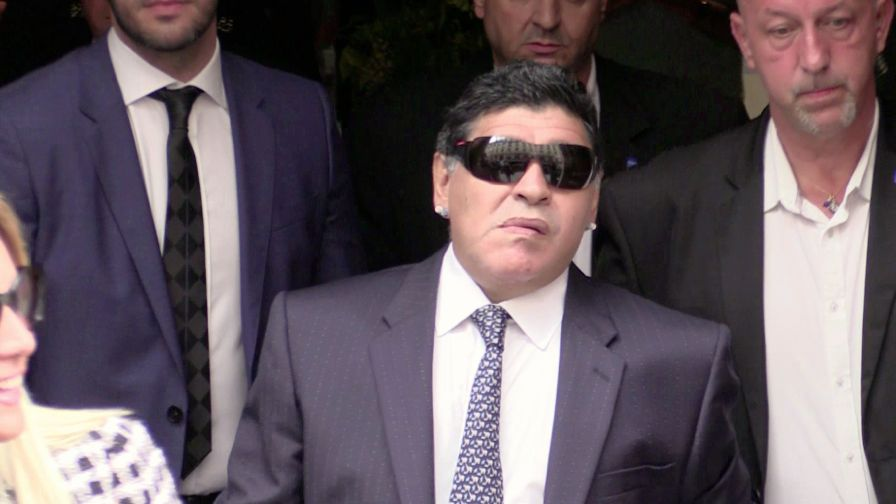 EXCLUSIVE - Maradona and wife coming out of the Sofitel hotel in Paris