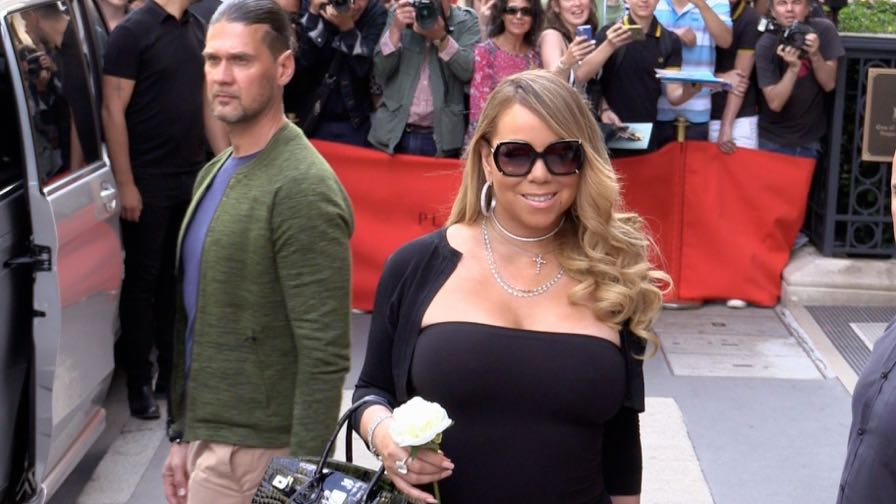 Mariah Carey and her twins come out of the Plaza Athenee hotel in Paris