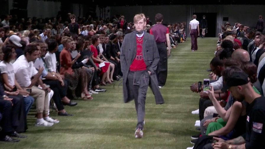 Models and designer on the runway for the Dior Homme Menswear show