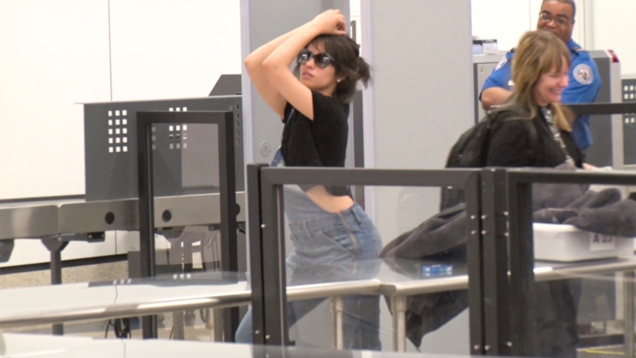 FRANCE ONLY - EXCLUSIVE - Camila Cabello Turns LAX TSA Into A Catwalk, Striking Poses For Photograph