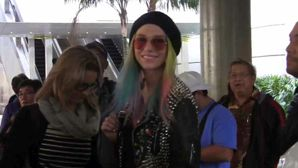 FRANCE ONLY - Ke$ha Shows Off Wacky Fashion, Greets Young Fan At LAX